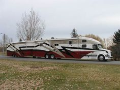 Volvo 780 Customized Coach, matching car and cargo hauling trailer, by Powerhouse Coaches.