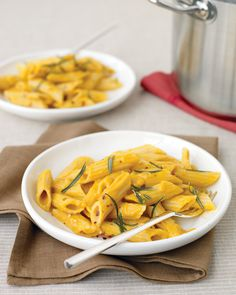 Penne with Creamy Pumpkin Sauce  INGREDIENTS 12 ounces penne rigate, Coarse salt 2 tablespoons olive oil 1 tablespoon fresh rosemary 1 can (15 ounces) pure pumpkin puree 1 garlic clove, minced 1/2 cup half-and-half 1/3 cup grated Parmesan 1 tablespoon white-wine vinegar 1/4 teaspoon red-pepper flakes, plus more for garnish (optional) Yogurt instead of 1/2 &1/2?