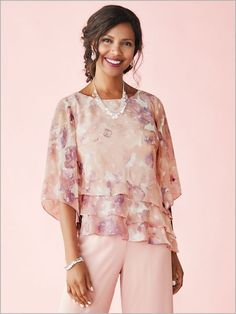 Finessed with flutter for exquisite charm. Designed with a burnout pattern of watercolor florals. With sheer ¾ sleeves and an asymmetrical hem with triple tiers. Body lined.