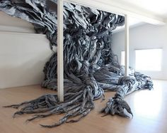 Installation by Wade Kavanaugh and Stephen B. Nguyen made of recycled wood and paper.