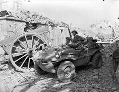 Personnel of the South Saskatchewan Regiment in a captured German 'Schwimmwagen' amphibious car of the Wehrmacht, Rocquancourt, France, 11 August 1944. (L- R) Maj. J.S. Edmondson, Pte. T. Schwartz, Capt. N.W. Hadley.
