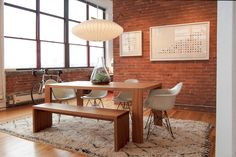 Brick, table, chairs, bench, light, windows - everything really! modern dining room by Adrienne DeRosa | Houzz