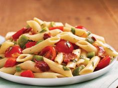 Bacon 'n Basil Pasta Salad  1    package (16 oz) penne pasta   1/2    lb sliced bacon   1    pint grape tomatoes, cut in half   2    medium red or green bell peppers or 1 of each, chopped (2 cups)   4    medium green onions, sliced (1/4 cup)   1/3    cup red wine vinegar   1    tablespoon Dijon mustard   1/2  cup olive oil   1/2    cup chopped fresh basil leaves   1    teaspoon salt   1/2    teaspoon freshly ground peppe