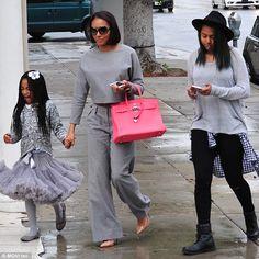 Lookalike daughters: Mel was walking alongside Angel, whose father is comedian Eddie Murph...