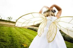 actually saw this idea at a wedding we designed.  Three flower girls had fairy wings, it was like a mid-summer's nights dream. So pretty! tble numbers: midsummer's night dream shakespeare, alice in wonderland, secret garden, thumbelina, tinkerbell, other fairytale stories, starry night- van gogh,