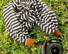 This chic black and white striped scarf camera strap is the perfect gift! Shop small and buy handmade with etsy.  Nikon, Canon, DSLR, photography