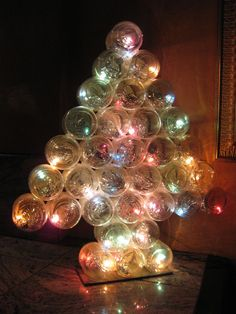 Christmas tree made out of baby food mason jars