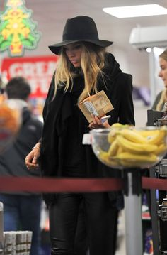 Victoria's Secret model Romee Strijd dives for the cookies after hitting the runway.