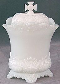 milk glass covered container with Cross finial.