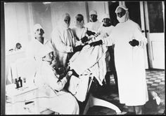 Jewish surgeon during an operation in Grodno, Poland.  Pictured are Dr. Chaim Blumstein and his staff.