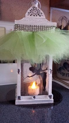 Tinkerbell diy gift.. I used a lantern, painted it white. Painted the glass with glitter paint and glued the silhouette to the inside glass peices. I glued the jewels to the outside and made the tutu top with the ribon. Placed in a fake candle. Really simple craft for any tink lover.