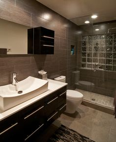 Tub, vanity, toilet shower. Push existing water closet out. Angled ceiling no problem, water source to come from overhead or back wall. This is how I would like to see the tile wrap around your space Bonnie. If we can work it in the budget.