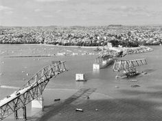 Auckland Harbour Bridge under construction, with section of bridge being manoeuvred into position on a barge, 29 November Bridge Construction, Under Construction, Saint William, Auckland, New Zealand, Beautiful Homes, Aviation, Beach, Water