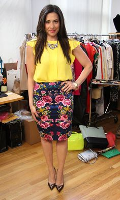 Stacy London.  Yellow Blouse and Floral Skirt by Zara. Bronze Pumps by Manolo Blahnik. Necklace by J. Crew. Green Earrings by Naz and Jaz Jewelry. Purple Ring by Bounkit, Silver Rings by Pamela Love, Rose Gold Chain Bracelet by Henri Bendel, Gold/Ivory Bracelet by Stephen Dweck.