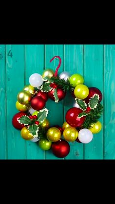 Christmas wreath made of old wire hanger and a selection of Christmas ornaments/