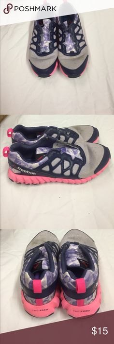 Reebok Twist Form Fitness Sneakers. Navy,Purple and Pink. Spots on toes of shoes. Bottoms are in good condition with much grip on them. Reebok Shoes Sneakers