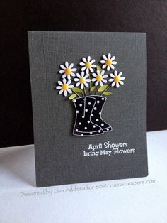 hand crafted card from I'm in Haven ... gray background with polka dot rain boots filled with punched daisies ... luv the yellow enamel dots centers ... fab card!