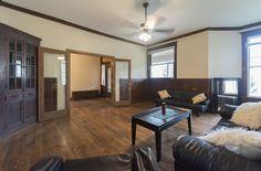 Living room with beautifully restored hardwood floors Stone Mansion, Hardwood Floors, Flooring, Washington Street, Renting A House, Mansions, Living Room, Table, Furniture
