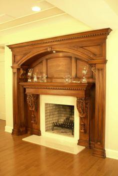 Fireplace set into paneled arch recess...
