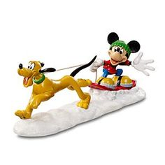 Disney Pluto and Mickey Mouse ''Dog Sledding'' Figurine by Dept. 56 | Disney StorePluto and Mickey Mouse ''Dog Sledding'' Figurine by Dept. 56 - Pluto takes Mickey for a ride with our ''Dog Sledding'' Figurine by Dept. 56. Mickey and his pal have a grand time enjoying a snow day. The joy of friends playing in winter makes a great addition to your Mickey's Holiday Village scene.