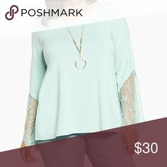 """LACE bell sleeve top We're trying to play it cool with top, but we just can't. The refreshing mint green knit is so soft and silky, it's literally love at first touch. The lace inset bell sleeves take our relationship with this top from casual to no chill.  Model is 5?10?, size 1      Size 1 measures 29 1/2"""" from shoulder     Polyester/rayon/spandex/nylon     Wash cold, dry flat     Imported plus size top torrid Tops Blouses"""