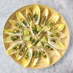 Call me the boat lady!  I love endive leaves as edible spoons  for party platters. Theyre sturdy enough and mild enough to hold all sorts of food in this case homemade guacamole  . . . perfect for guests who dont eat tortilla chips! Dont get me wrong I love those but not always and this keep your guac indulgence healthy but also really pretty.   Happy Friday everyone!   #healthibella #healthcoach Homemade Guacamole, Party Platters, Tortilla Chips, Zurich, Charcuterie, Spoons, Happy Friday, Pasta Salad, Apps