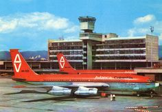 """Avianca Boeing 720-047B HK-723 """"Ricaurte"""" and Avianca Boeing 707-359B HK-1410 """"Bolivar"""" parked in the shadow of the Control Tower at Bogotá-El Dorado, circa August 1974. Both aircraft would be written off in landing accidents: HK-723 after it bounced on landing and overshot the runway during a rain squall at Mexico City-International, 16th August 1976; and HK-1410 when it landed too fast, too far down the runway, and consequently overshot at Quito-Mariscal Sucre, 27th January 1980. Boeing 720, Best Airlines, Commercial Aircraft, Quito, Mexico City, Airplanes, Things That Bounce, Aviation, 16 August"""