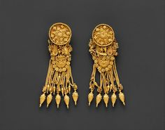 Gold earrings with disk and boat-shaped pendant. Hellenistic, ca. 300 B.C. Collection of The Metropolitan Museum of Art.