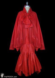 Norma Kamali iconic 1980s parachute dress, coat dress, avant garde, massive dolman sleeves, trumpet hem, tomato red by TheFrockDotCom on Etsy https://www.etsy.com/se-en/listing/259376671/norma-kamali-iconic-1980s-parachute