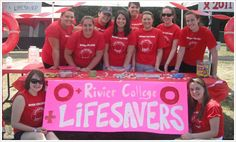 Rivier college Students Participate in Overnight Cancer Research Fundraiser. A team of ten students from Rivier College joined together to participate in an American Cancer Society (ACS) Relay for Life, an overnight fundraiser to benefit the ACS's work. The team, called the Rivier College Life Savers, raised $1,700