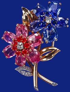 QE II, Pink and blue sapphire, diamond and ruby brooch made by Cartier, (the LondonFlower Spray Brooch)
