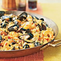 Paella Valencia.Valencia is a Spanish coastal city where this dish is particularly revered. Sausage and chicken combine with seafood and veggies in this traditional gourmet production.