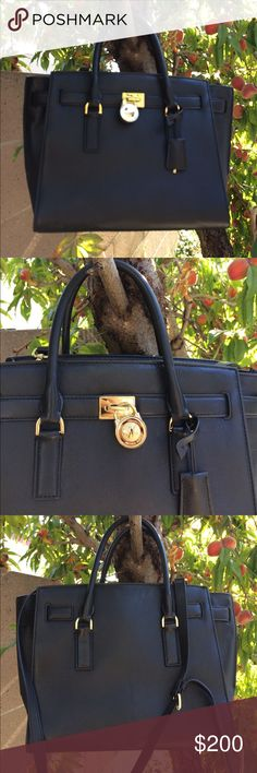 Michael Kors Hamilton black leather satchel Michael Kors Hamilton black leather satchel. Has only been worn about 3-4x. In very clean like new condition. Comes with dust bag. Michael Kors Bags Satchels