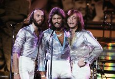 Pop vocal trio the Bee Gees performing at the Music for UNICEF Concert at the United Nations General Assembly in New York City, January 1979. Left to right: Maurice (1949 - 2003), Barry, and Robin Gibb.