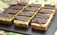Learn how to make this Canadian treat at home. Nanaimo Bars are a wonderfully rich and creamy treat during the holidays. A Canadian tradition, Nanaimo Bars are a delicious holiday dessert. rich and velvety with just the right amount of chocolate. Nanaimo Bars, Holiday Baking, Christmas Baking, Köstliche Desserts, Dessert Recipes, Bar Recipes, Sweet Desserts, Yummy Recipes, Waffle
