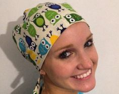 Blue and green owls on off-white background   Traditional tie back, pixie style scrub hat.
