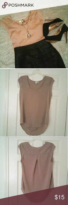 💥BOGO 50% off💥 14th & Union taupe tunic top Shimmery taupe tunic top with capped sleeves, boat neckline, pleated back, and asymmetrical design is a beautiful addition to any woman's wardrobe. Very versatile and comfortable. Pair with skinny jeans and sandals or heels or tuck in to a high waisted skirt with a statement necklace.  Size S. Designed to fit loosely. Taupe color has a bit of a purplish tint.   Disclaimer: Lighting varied color of tunic in 1st photo. True color is shown in…