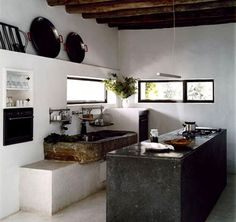 Wabi-Sabi Kitchen reflects the wabi-sabi ideal of a simple space that reveals its loving use.