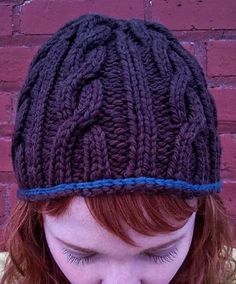 "Whip up this easy-to-knit cabled beanie in no time flat! You just need one skein of Lorna's Laces Shepherd Bulky; if you'd like to crochet a contrasting edge, simply mine your stash for a small amount of yarn in a coordinating color!Supplies: Size 9 16"" circular needles Size 10 16"" circular needles Size 10 DPN's Cable Needle (CN) Tapestry Needle 1 skein Lorna's Laces Shepherd Bulky Optional: Small amount of contrasting yarn for crocheted edging and size H crochet hoo..."