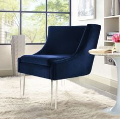 - Info - Features - Colors - Dimensions The classy yet stylish look of our Lycia velvet chair is tapered to perfection. The sumptuous soft velvet upholstery and tall Lucite legs provide subtle eleganc
