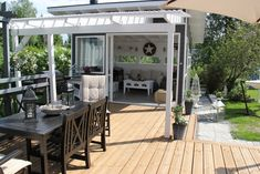 Nice looking outdoor space. I think the summer room part of this is store-bought but we could do something similar from old windows etc. Outside Room, Outside Living, Outdoor Living, Patio Pergola, Deck With Pergola, Backyard, Outdoor Spaces, Outdoor Decor, Summer Kitchen