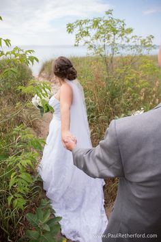 photo follow me to lake michigan wedding photo by Paul Retherford Photography, http://www.PaulRetherford.com in leland, Michigan in a Mon Cheri dress and DIY flowers #lakemichigan #leland #wedding #puremichigan #weddingday #weddingidea #weddinginspiration