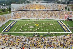 """The signature formation of """"The Pride of West Virginia"""" is the creation of the state near the end of """"Country Roads."""" Football game days come alive when """"The Pride"""" takes on the shape of West Virginia during """"Hail West Virginia"""" and marches end zone to end zone to the delight of Mountaineer fans."""