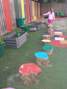 Our local childcare centre has rescued a fallen tree and cut pieces to make a lovely garden border which also doubles as stepping stones. The bright colours look amazing and what a great way for kids to practice their balancing skills! The use of wood a Kids Outdoor Play, Outdoor Play Spaces, Kids Play Area, Outdoor Learning, Backyard For Kids, Outdoor Areas, Indoor Outdoor, Preschool Playground, Preschool Garden