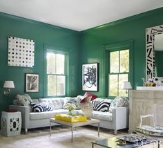 For Oscar de la Renta's OscarPRGirl, Miles Redd crafted this ultra-green living room with Benjamin Moore Impervo in Very Green, a Dune sofa, a Louis XV-style armchair found at Christie's, and a Treillage stool.