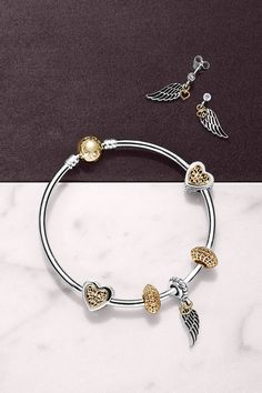 PANDORA's filigree angel wing charm and earrings with dangling 14k gold hearts are the perfect present to represent love and guidance. #PANDORAearrings #PANDORAbracelet