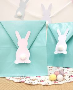 Have at go at making these easy DIY Easter party bags with blue paper bags and our free printables! A fun Easter craft for kids and a super easy Easter party idea!