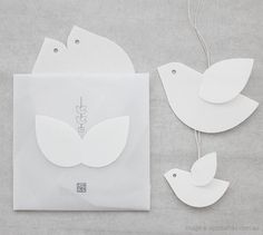 this set of three birds can can also be displayed as separate ornaments or used as greeting cards