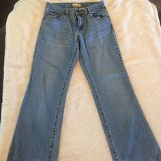 BOYS OLD NAVY BOOTCUT JEANS SIZE 16 These are boys Bootcut jeans from Old Navy.  They are in excellent condition and have a faded look to it.  The waist is adjustable. Old Navy Jeans Boot Cut