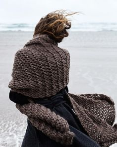 "morphknitwear: "" Another shot from the Seafaring Wanderer editorial because I just can't get over how gorgeous all the textures look. Shot by model wearing the Diedre scarf in camel and the Euna Merino Wool skirt "" Winter Beach, Seafarer, Am Meer, Brown Dress, Wool Skirts, Models, Knitwear, Pullover, Knitting"
